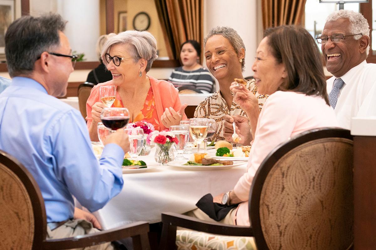 A group having an elegant dinner together.