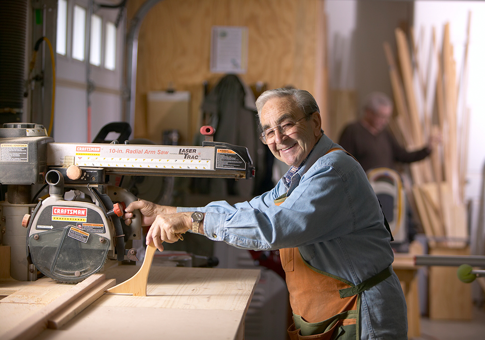A senior working in a woodshop.