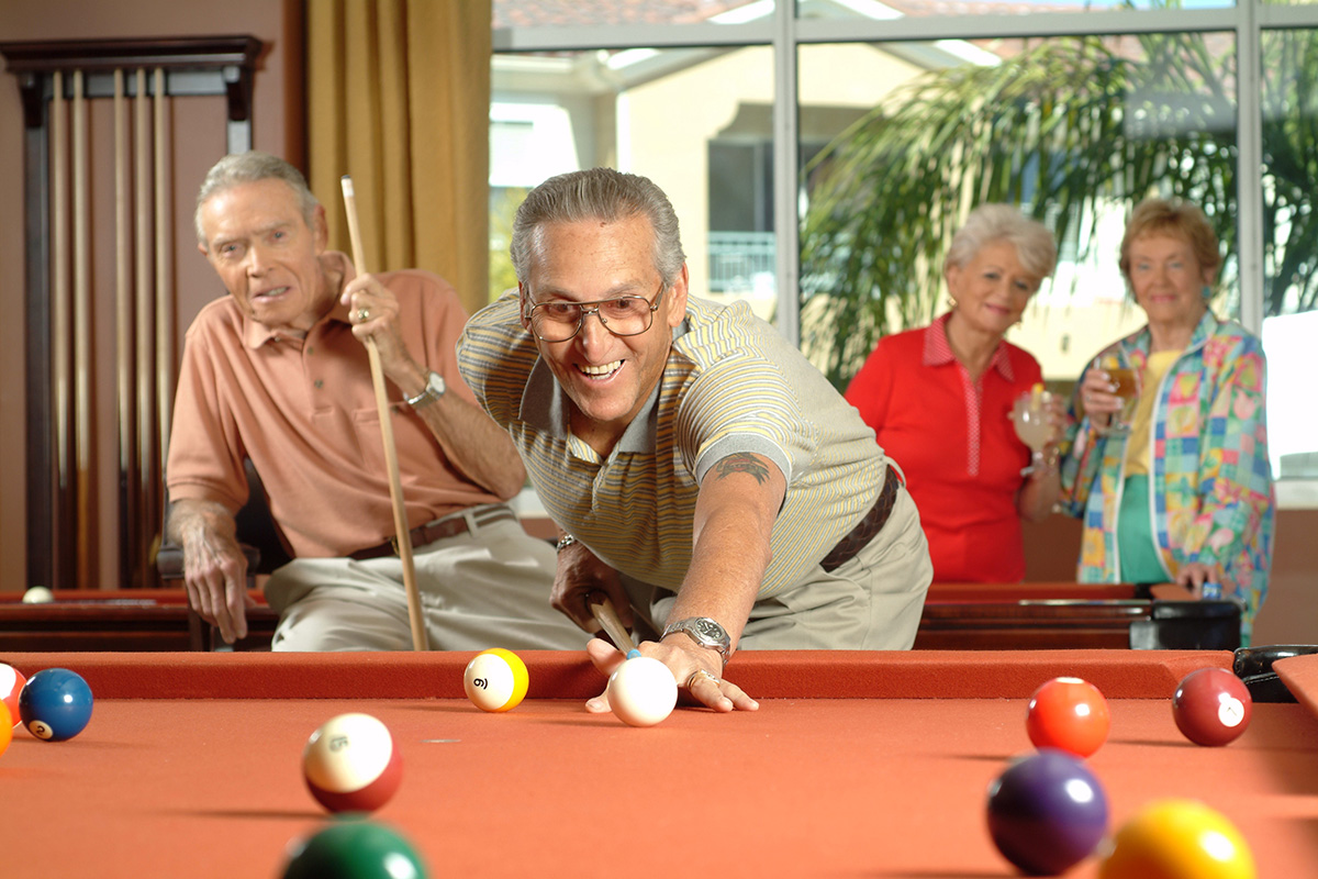 Residents playing pool.