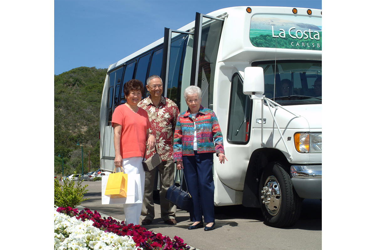 Three residents in front of the LaCosta Glen bus.