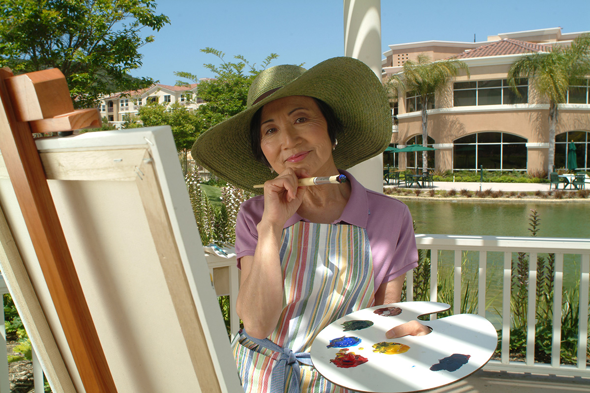 A resident paiting outdoors.