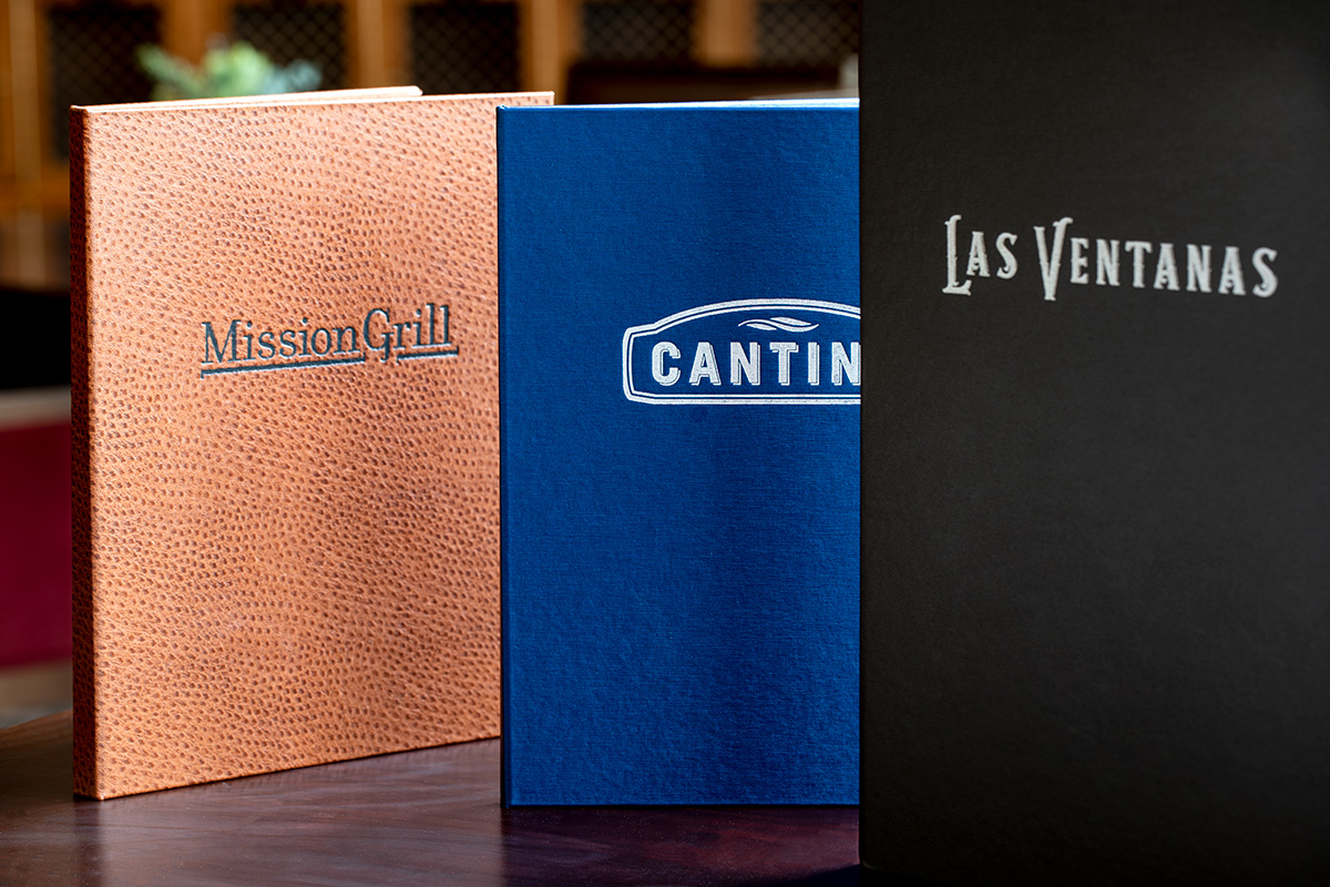 Three menus from restaurants at the facilities such as Mission Grill, Cantina, and Las Ventanas