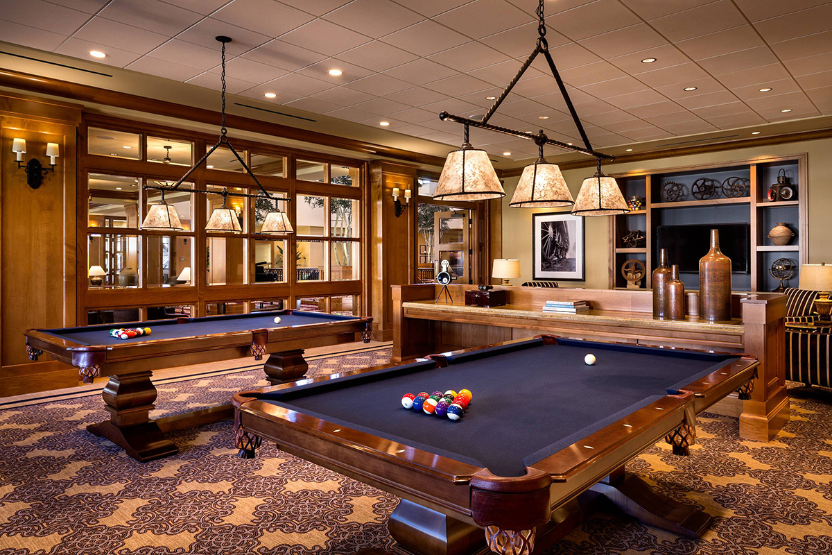 Activity room with pool tables set up for resident use.