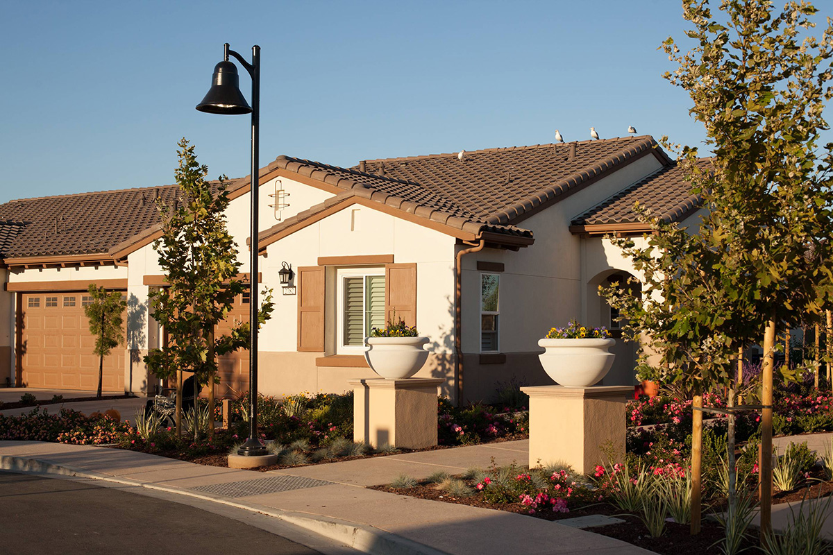 Resident homes with garages and manicured landscaping out front.