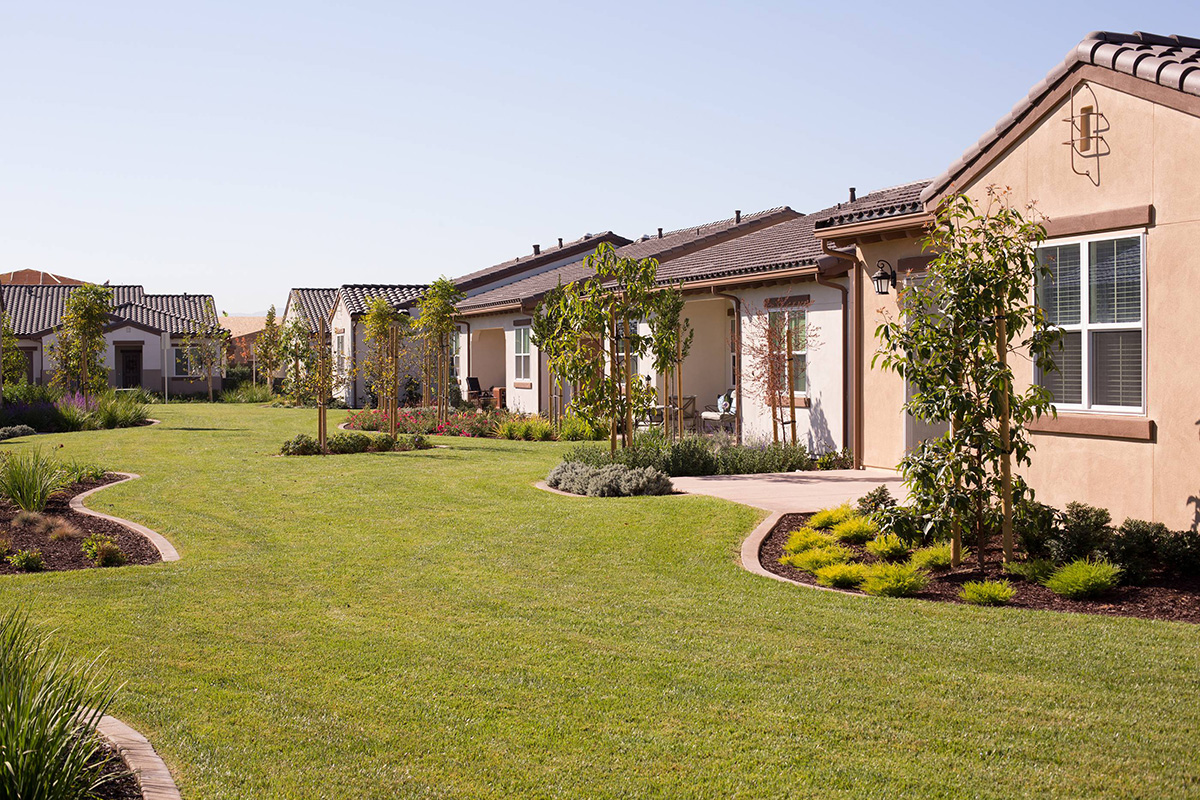 Residential homes with manicured front yards.