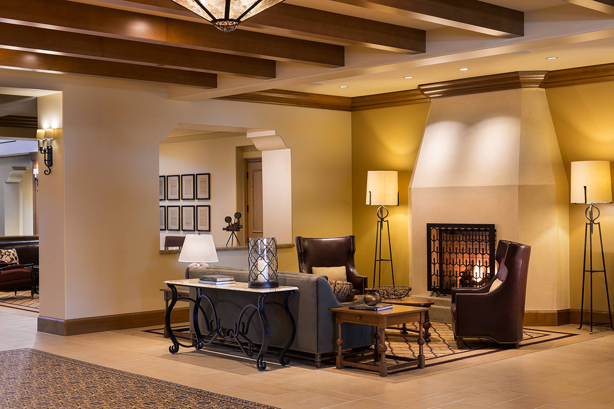 Seating areas beside a large lit fireplace.