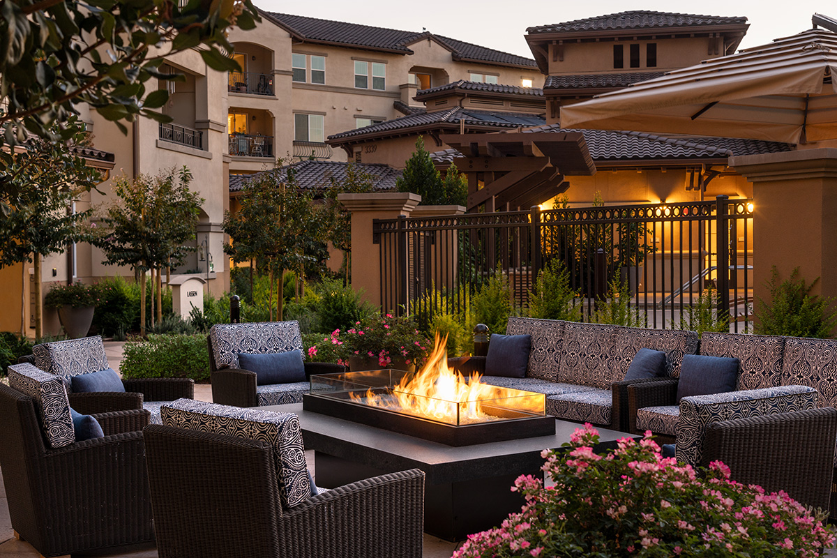 Outside seating beside an outdoor fire pit.