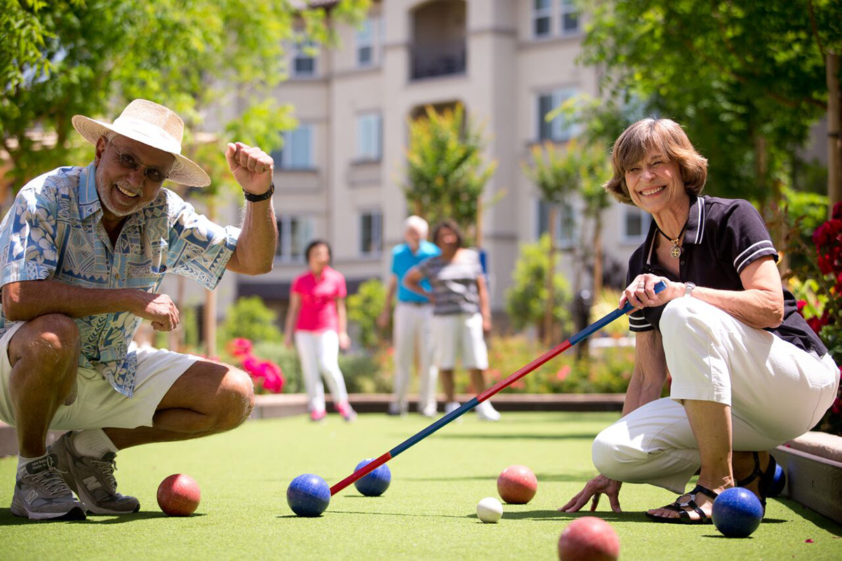 Residents enjoying a game of bocce ball.