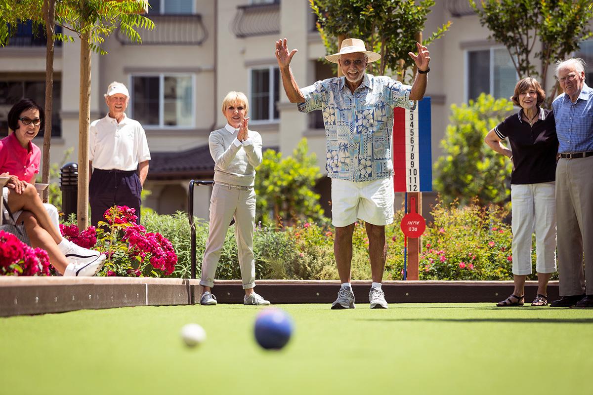 Stoneridge Creek residents playing bocce ball.