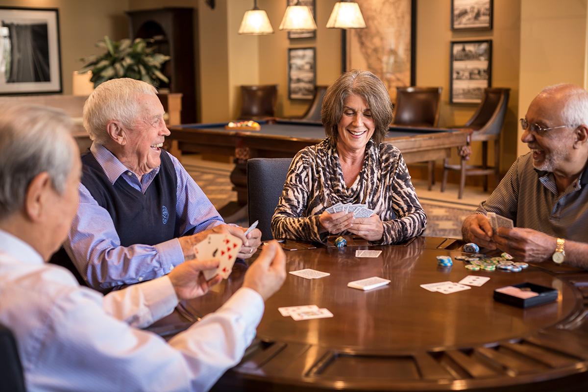 Stoneridge Creek happy residents playing poker.