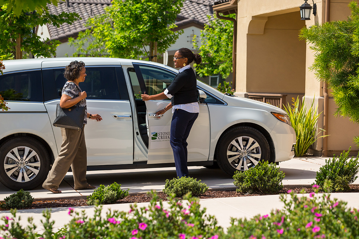 Stoneridge Creek resident being picked up by the community transportation service