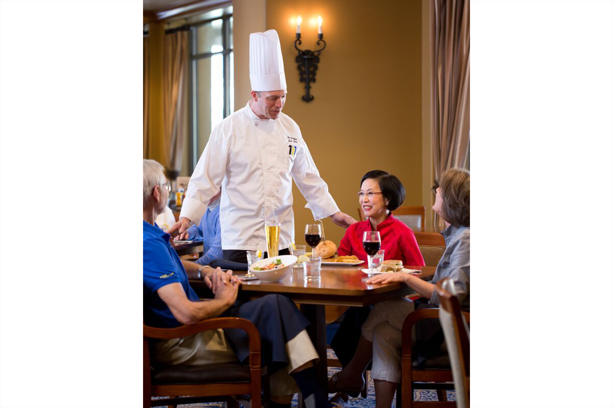 Stoneridge Creek Grill Chef greeting residents