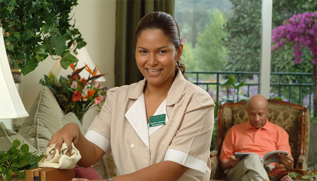 Housekeeping smiling while working.