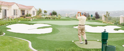 Seniors outdoors golfing.