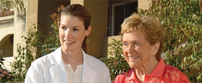 Two women smiling outside.