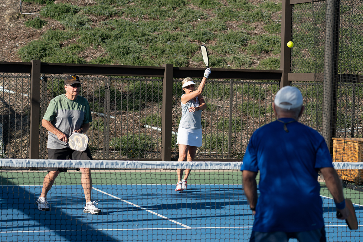 Residents playing tennis together.