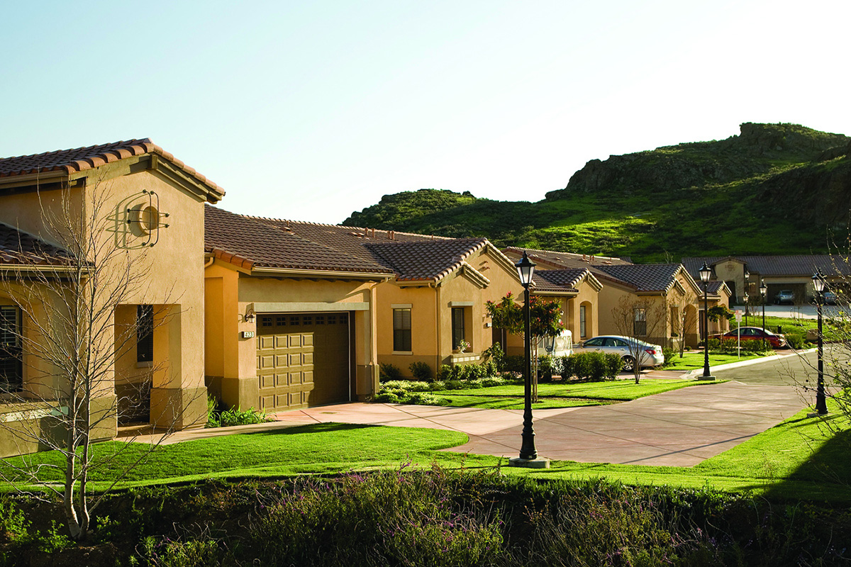 Resident homes with garages and mountain view.