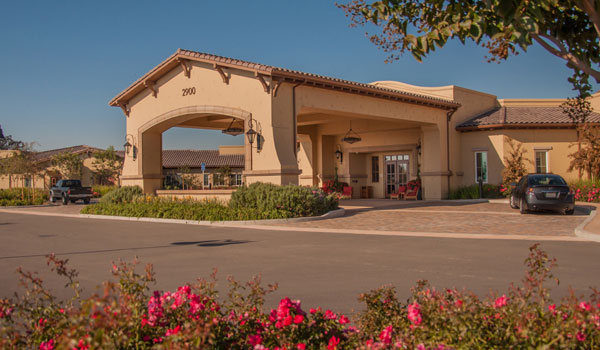 Creekview Health Center shaded entrance and driveway.