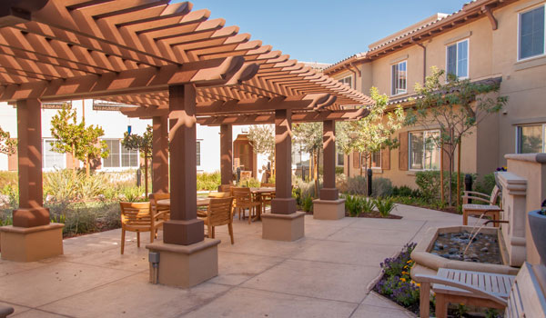 Outside pergola with seating.