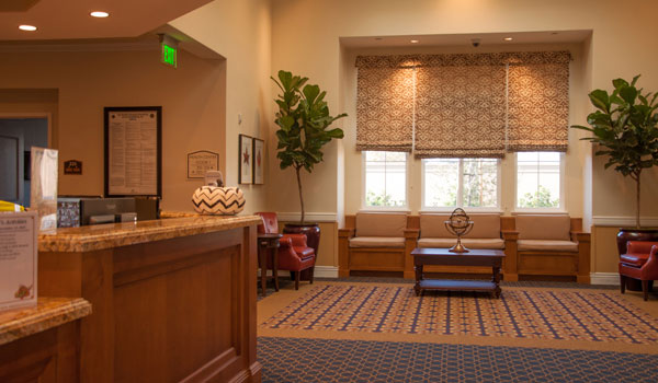 Lobby with a desk and seating options.