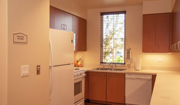Kitchen area with refrigerator, sink, cabinets, dishwasher and oven.