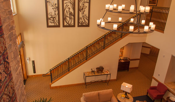 Large staircase and chandelier.