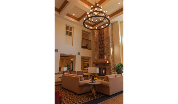 Large chandelier above the seating area and fireplace.