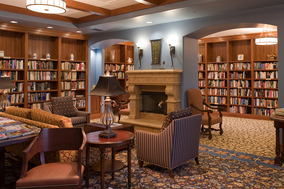 A large library with seating and books.
