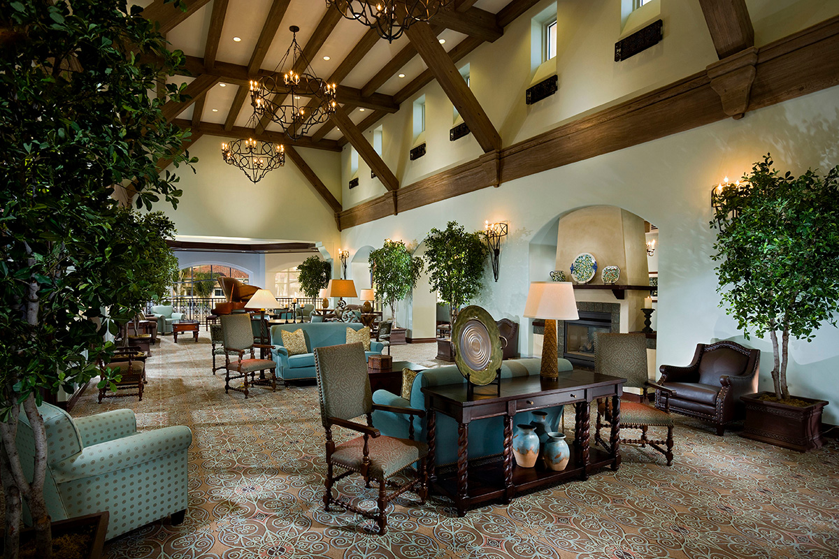 Large lobby with vaulted ceiling and comfortable seating.