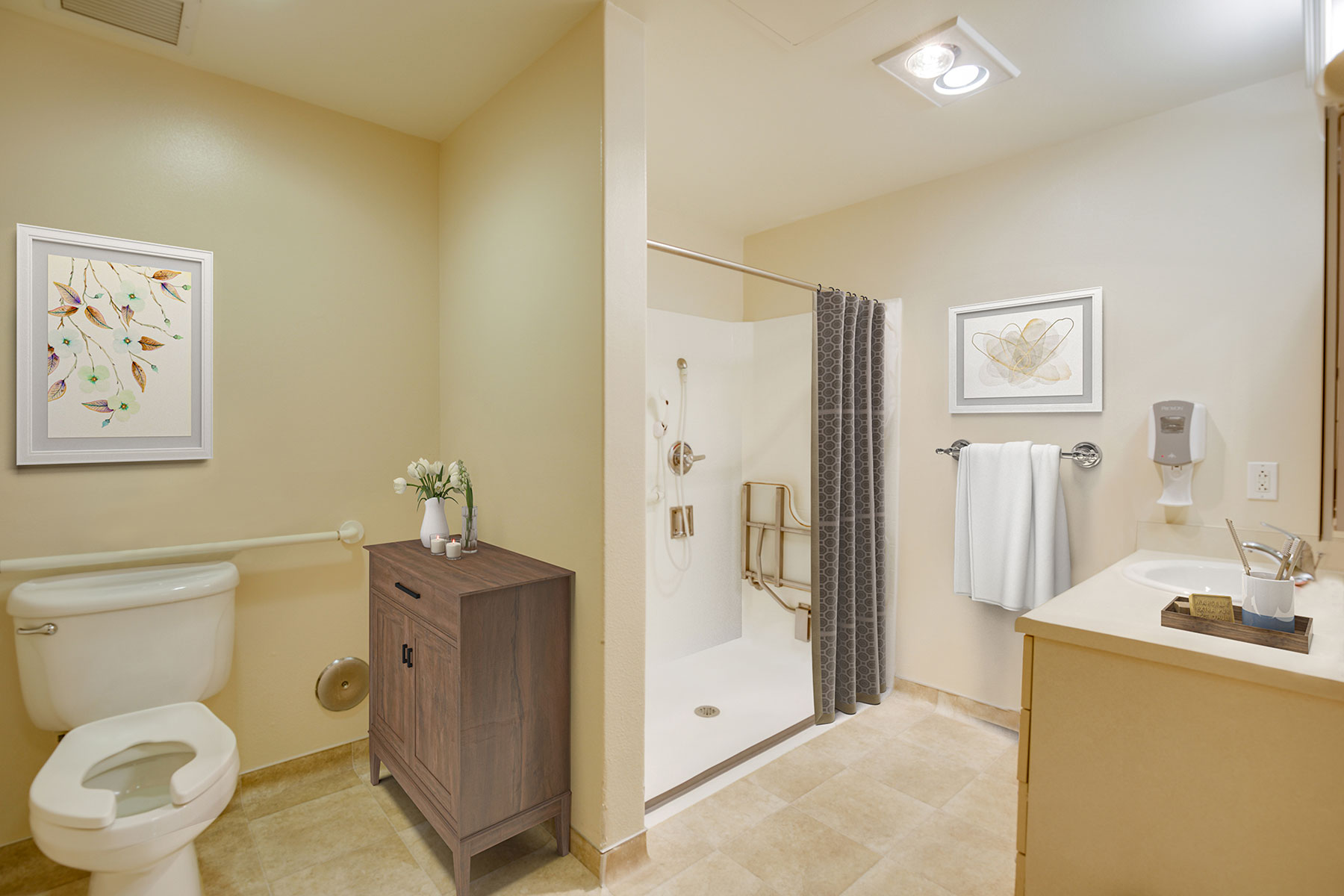 Large bathroom with shower and handicapped accessible bars and equipment.