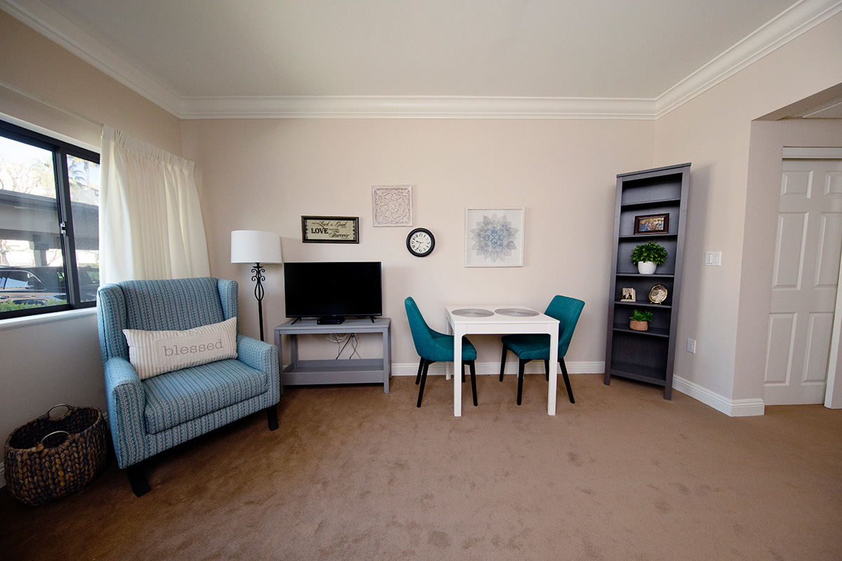 A room with a chair and a television.