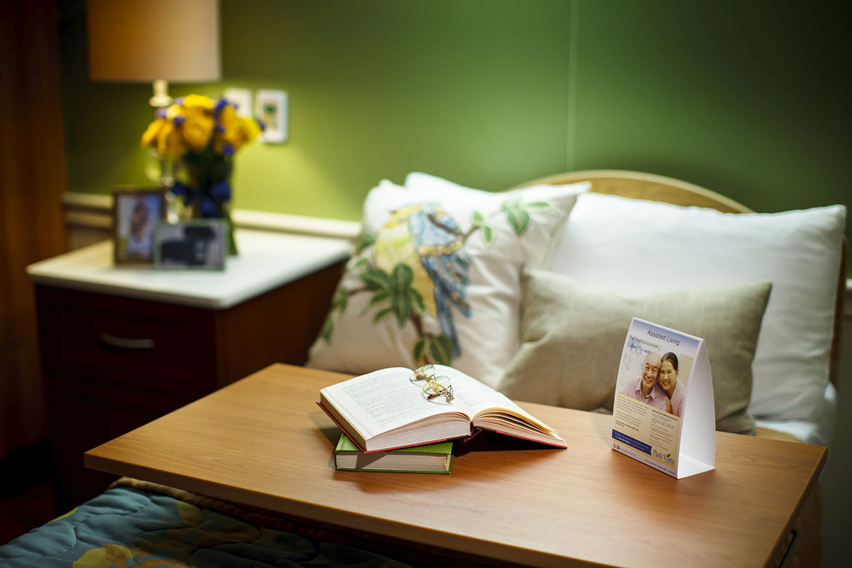 A bed and books lying on a table.