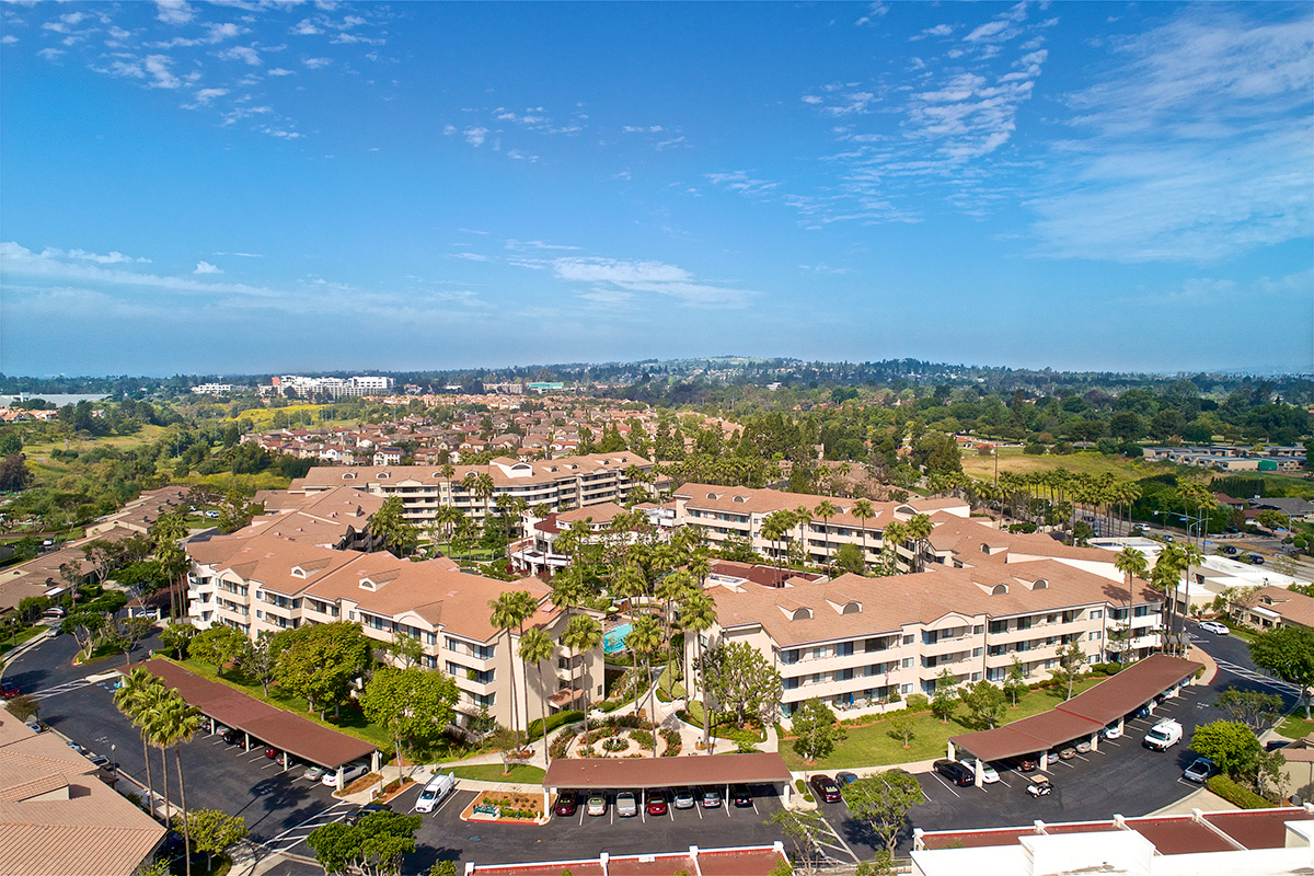 Drone view of the community buildings, parking lots, and surrounding area.