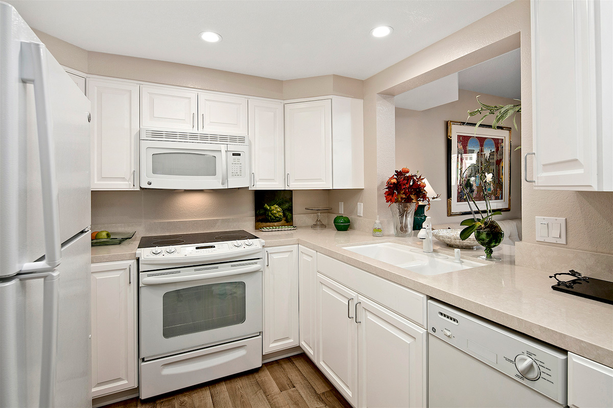 Kitchen with oven, sink, microwave and stove.