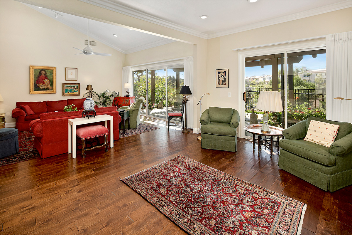 Large living room with large outside patio.