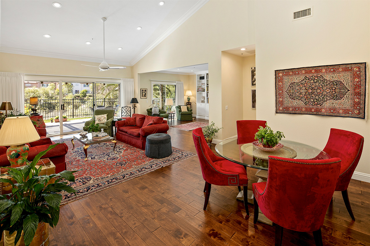 A large living room, dining room, and sitting area that opens up to a large patio.