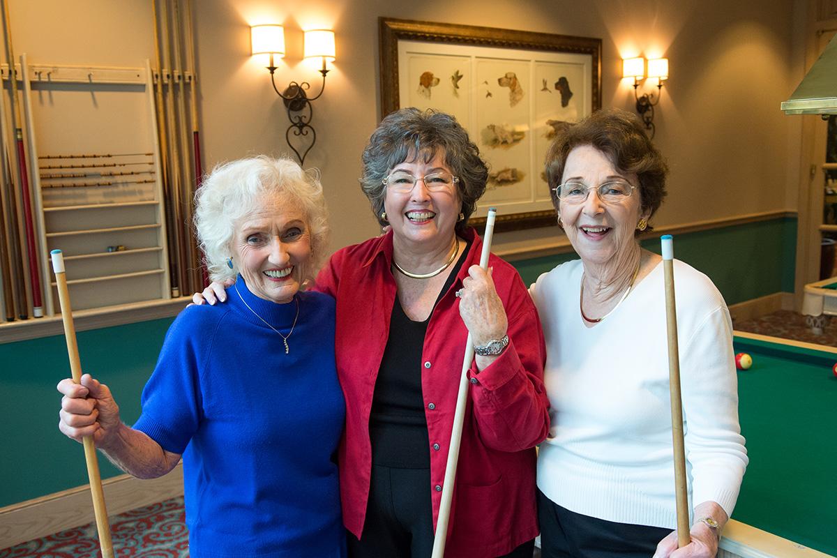 Three ladies playing poker.