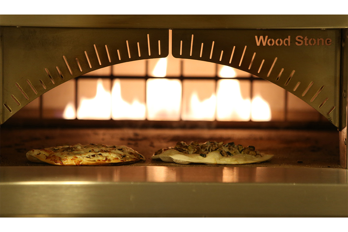 Wood stone stove cooking pizzas.